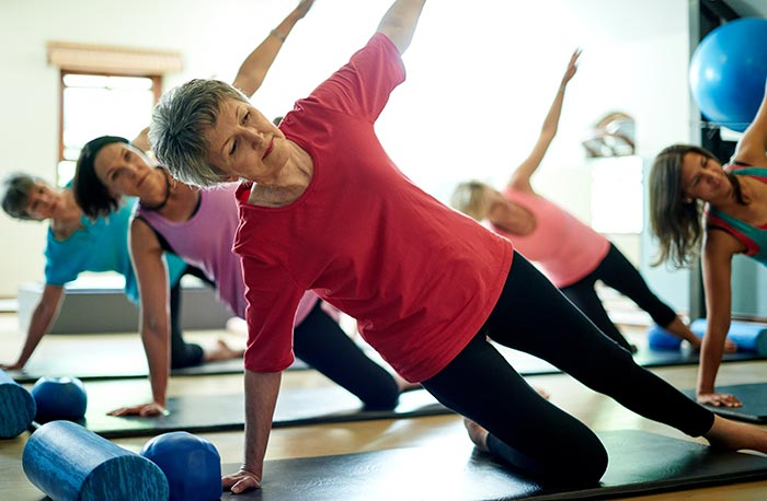 Yoga class with women participating over 60.